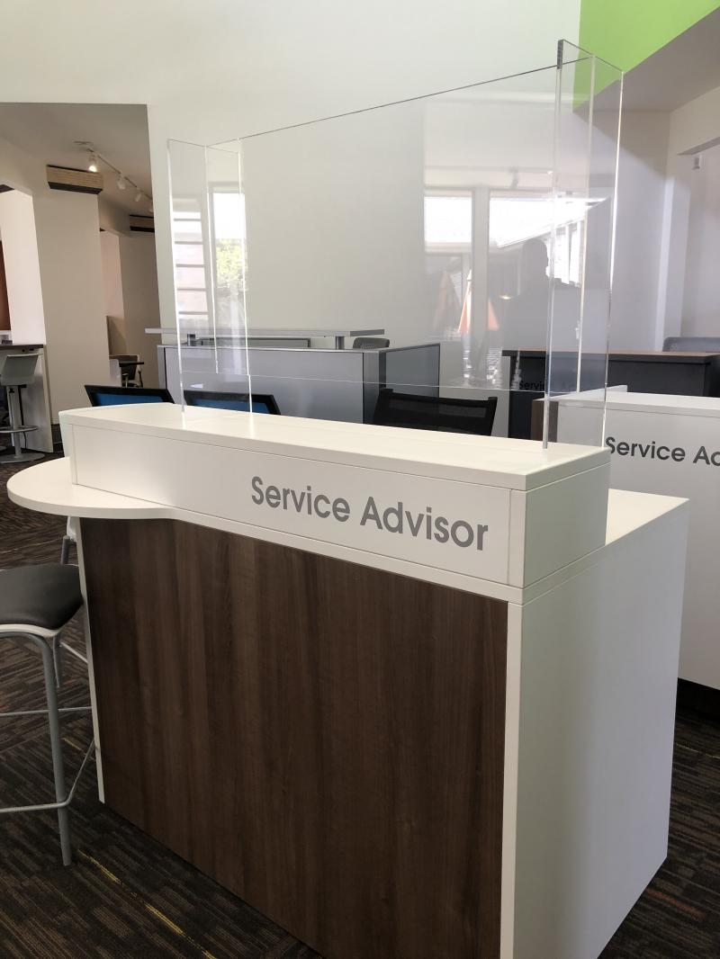 service advisor podium with PPE sneeze shield / guard